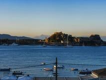 Boats in the bay of Corfu Town on  the Greek Island of Corfu Royalty Free Stock Image