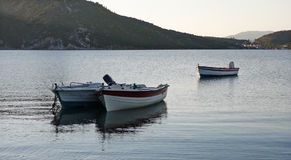 Boats in a bay. In the evening stock image