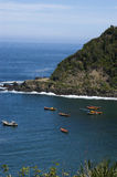 Boats in the bay. Fishing boats in the midst of Bahia Mansa, coast of Osorno, Chile Royalty Free Stock Image
