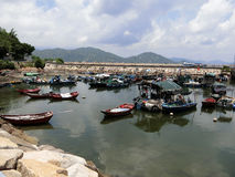 Boats in the Bay. Hong Kong July 2016 - Boats floating in a small bay on Cheung Chau Island in Hong Kong stock photography
