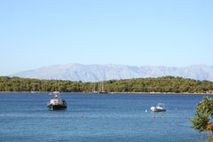 Boats in the bay with a mountain in the background. Stock Photo