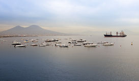 The boats in a bay of Naples, Italy, in the foggy morning Royalty Free Stock Photography