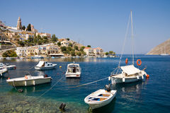 Boats in bay of symi island Royalty Free Stock Images