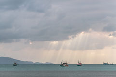 Boats in the bay , Thailand. Sunlight through the clouds to the sea Stock Image