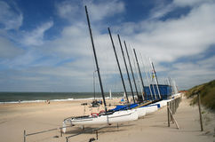 Boats on the Beach. Sailing boats pulled up on the beach stock image