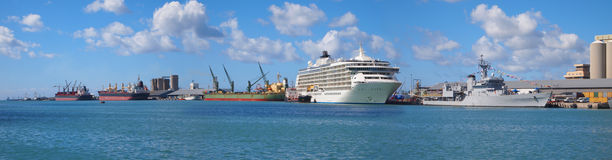 Boats at the beach. Giant passenger ship parked at Port Louis Harbour in Mauritius Stock Image