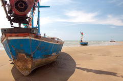 Boats on the beach. Wooden fishing boats on the beach Stock Images