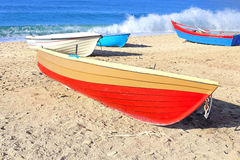 Boats on a beach Stock Images