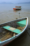 Boats on Beach. Boats for hire rest on a sandy beach Stock Photos