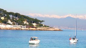 Boats in a beach in Antibes, Cote d'Azur stock footage