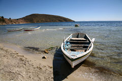 Boats on beach, Bolivia. Boats on the Isla del Sol in the Lago Titicaca Lake Royalty Free Stock Photo