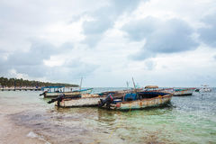Boats on the beach in Cabeza de Torro in cloudy day, Punta Cana Royalty Free Stock Photo