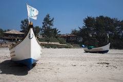 Boats on beach in Goa. Two boats in Mandrem beach, Goa, India Royalty Free Stock Photos