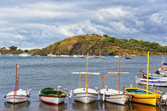 Boats on the beach and harbor at stormy weather Stock Photos