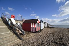 Boats and beach huts on Thorpe Bay beach, Essex, England Stock Photos
