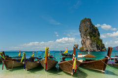 Boats on the beach. Long-tail boats on rock background. Thailand Royalty Free Stock Photography