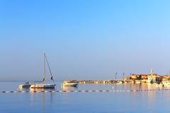 Boats on the beach near the old town of Budva Stock Photos