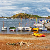 Boats on the beach and pier at stormy weather Royalty Free Stock Photo