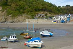 Boats on beach at Polkerris, Cornwall, England Stock Photos