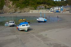 Boats on beach at Polkerris, Cornwall, England Stock Images