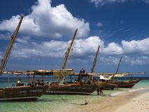 Boats on the beach, romantic turquoise sea royalty free stock image