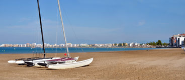 Boats on the beach of Roses in Spain. Royalty Free Stock Photography