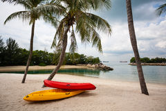 Boats on beach of Sentosa Island in Singapore. Stock Photo