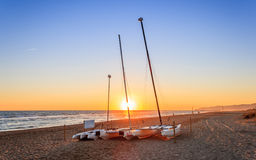 Boats on the beach. In sunset and blue sky Stock Photography