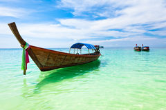 Boats on the beach, Thailand. Traditional wooden boat on the beach of Koh Lipe Island, Thailand royalty free stock images