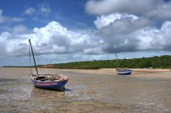 Boats on Beach. There are two boats beached on the beach in Mozambique in the vilanculos area Royalty Free Stock Photo