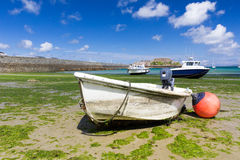 Boats beached at low tide Royalty Free Stock Image