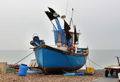 Boats beached on a shingle beach Stock Photo