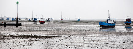 Boats beached at Southend at low tide. Motor boats and yachts beached on the sands at Southend on the Thames estuary Royalty Free Stock Images