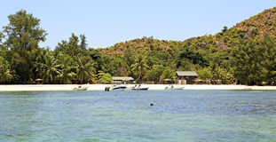 Boats at the beautiful beach of Curieuse Island in Indian Ocean. Royalty Free Stock Image