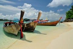 Boats on beautiful beach at Phi Phi island Royalty Free Stock Photos
