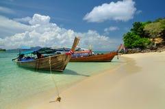 Boats on beautiful beach at Phi Phi island Royalty Free Stock Image