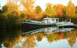 Boats and beautiful fall forest Royalty Free Stock Photo