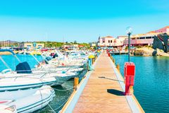 Boats and Beautiful Marina of Villasimius at the Bay of the Blue Waters of the Mediterranean Sea on Sardinia Island, in Italy in. Summer. Cagliari region stock images