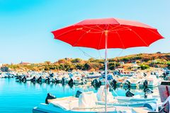 Boats at Beautiful Port of Villasimius at the Bay of the Blue Waters of the Mediterranean Sea on Sardinia Island in Italy in. Summer. Cagliari region stock photography