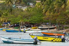 Boats in Bequia, caribbean. Seafront in the island of Bequia, Grenadines Stock Image