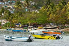 Boats in Bequia, caribbean. Seafront in the island of Bequia, Grenadines Royalty Free Stock Photos