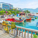 The boats and bicycle in Alanya port Stock Photography