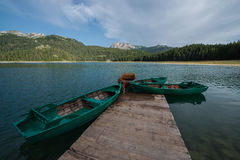 4 boats on the black lake, Durmitor, Montenegro. Crno Jezero (Black Lake) is premium tourist attraction of Durmitor area. It is the biggest and the best known of Stock Photography