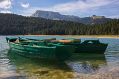 Boats in black lake in Durmitor national park in M. Ontenegro, Europe Royalty Free Stock Photography