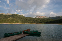 4 boats on the black lake. Durmitor national park, Montenegro Royalty Free Stock Image