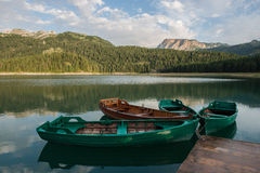 4 boats on the black lake. 4 row boats on the black lake, Durmitor national park, Montenegro Royalty Free Stock Photos