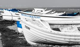 Boats in black, white and blue royalty free stock photo