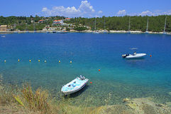Boats in blue cove,Greece Royalty Free Stock Photography