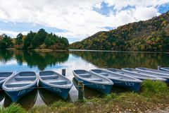 Boats on blue lake and blue sky nature scenic view, panorama Royalty Free Stock Image