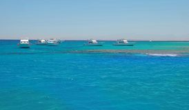 Boats on blue sea water in Egypt Royalty Free Stock Photography